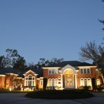 Brick mansion with outdoor lighting