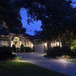 Well-lit home and driveway