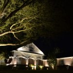 Beautiful home with yard lighting