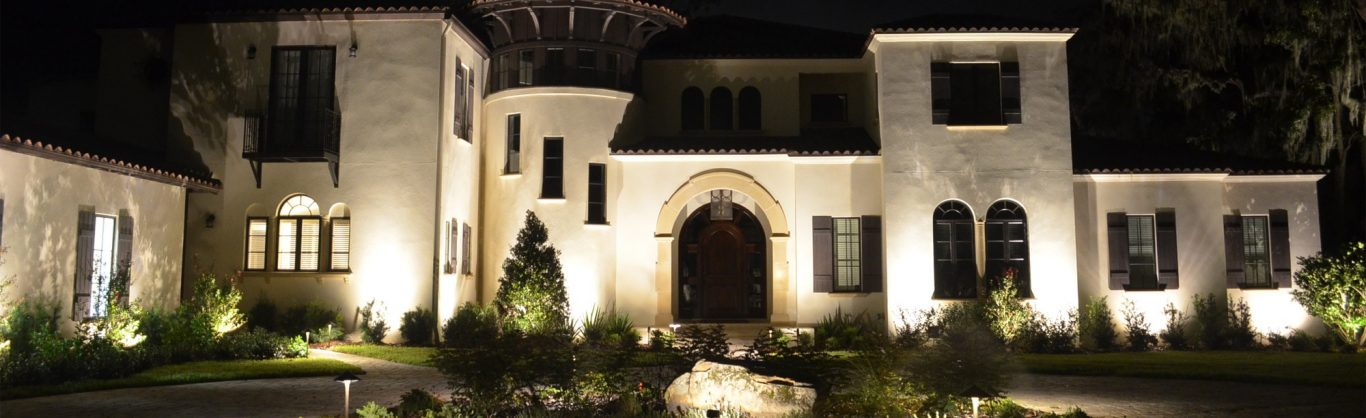 Large home with exterior lighting