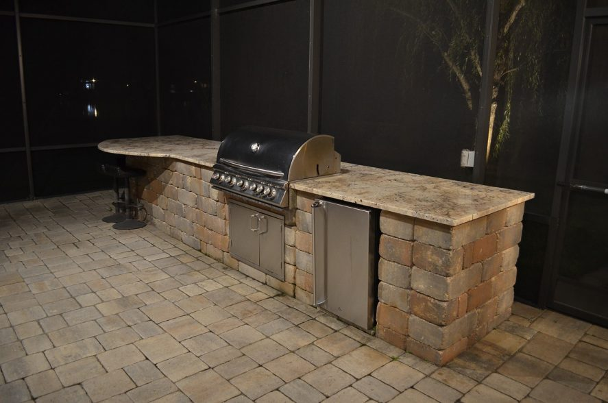 Backyard patio lighting for outdoor kitchen in Jacksonville