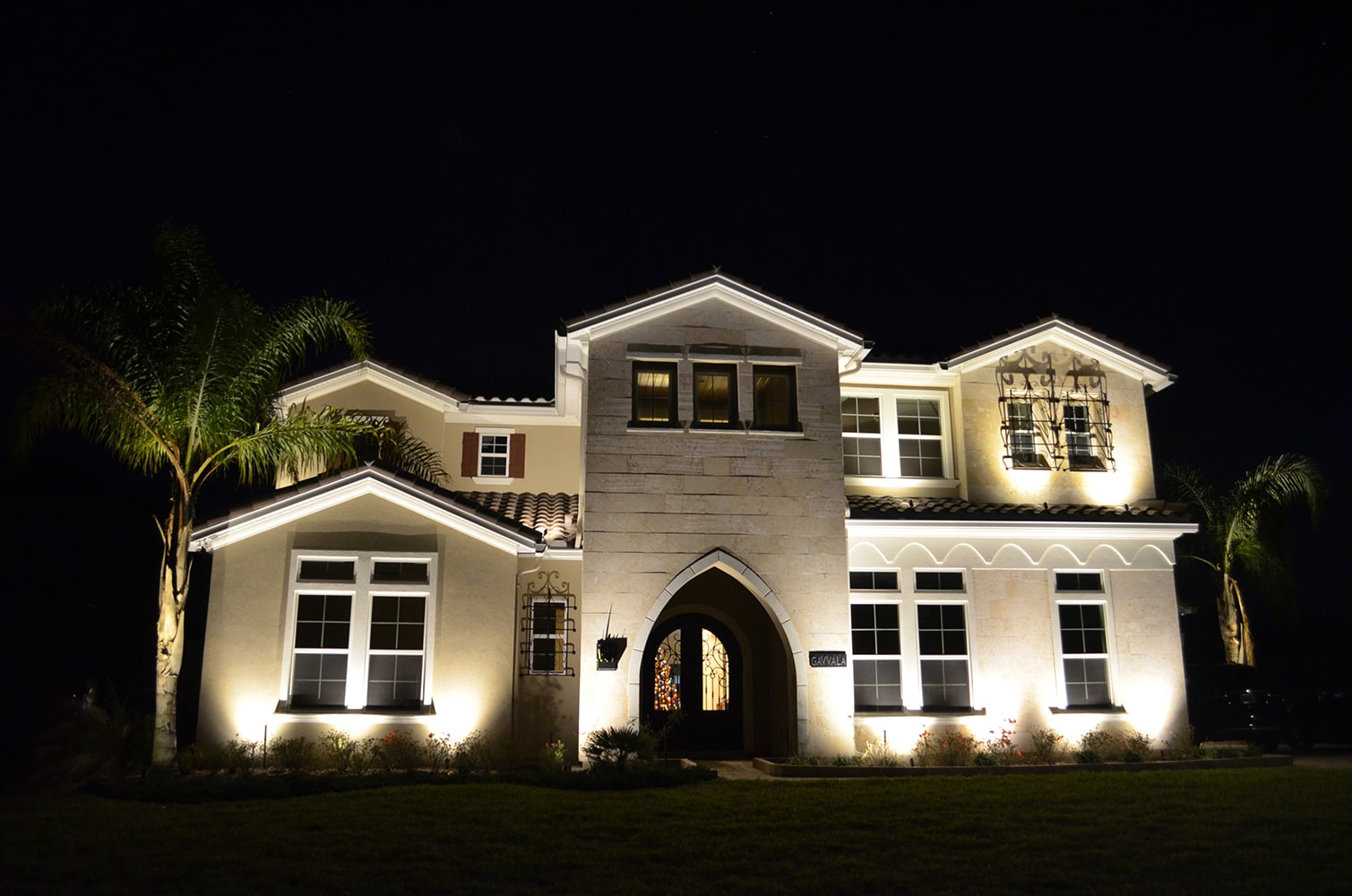 Front entrance with exterior lights