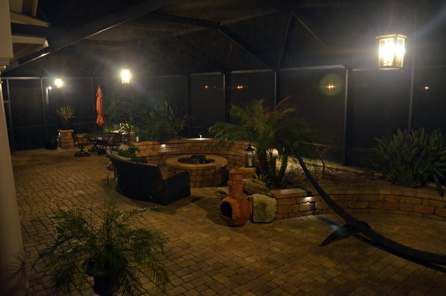 lanai backyard patio fireplace and summer kitchen lighting in Jacksonville